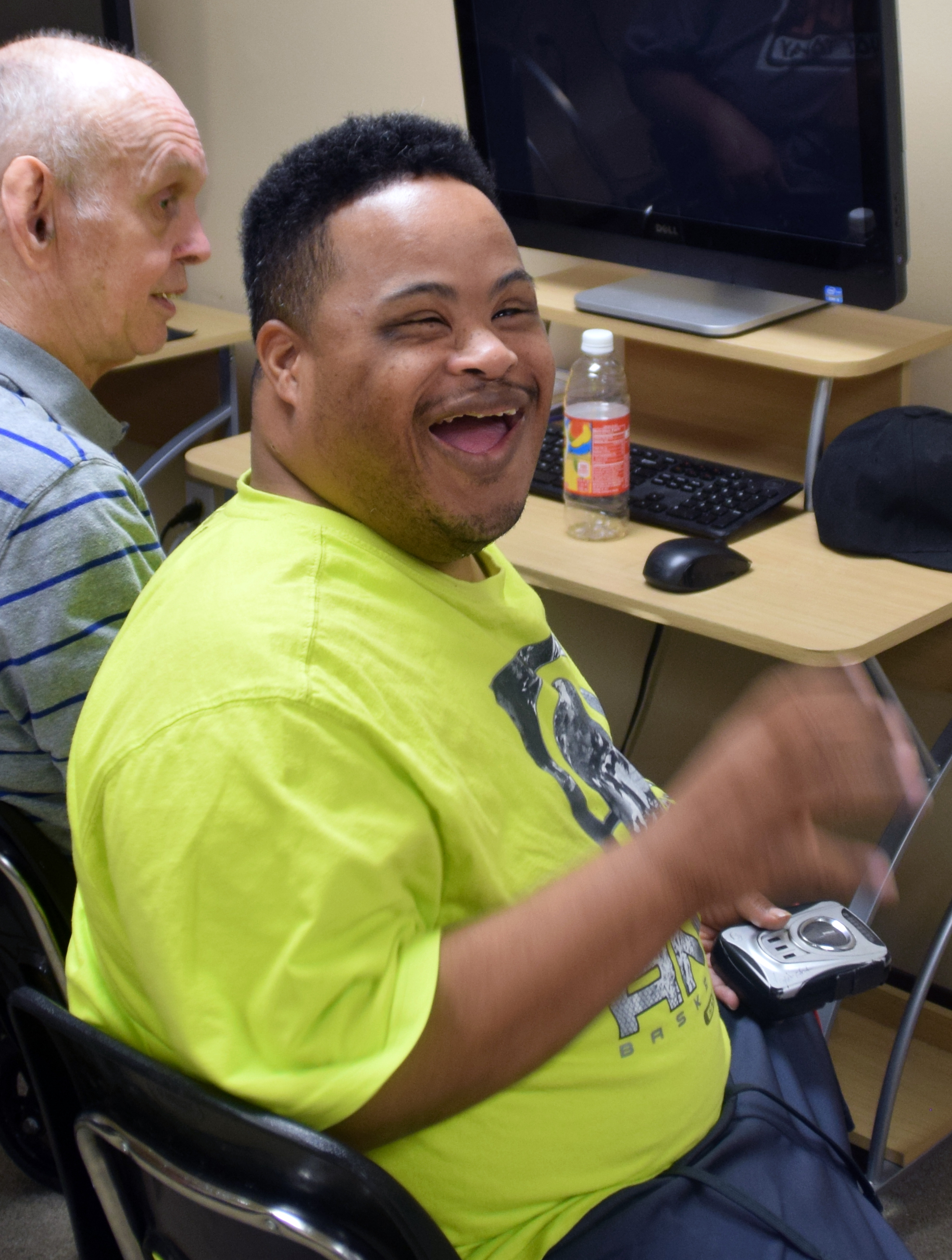 A disabled man looking at the camera and smiling in Burlington, NJ