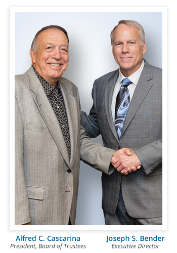 Alfred C. Cascarina President, Board of Trustees, shaking hands with Joseph S. Bender, Executive Director of Occupational Training Center in Burlington, NJ