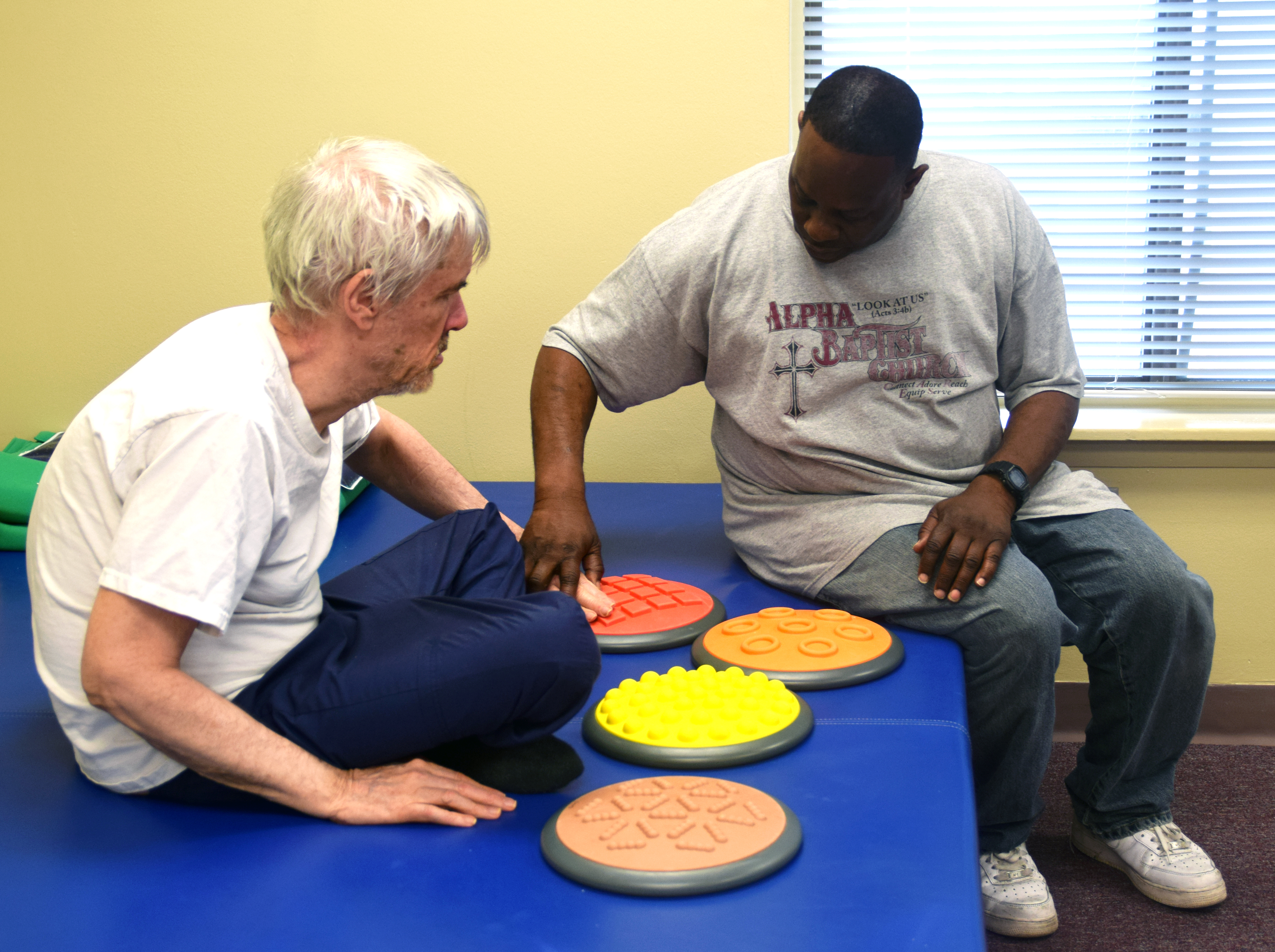 A staff member works with a client on sensory integration
